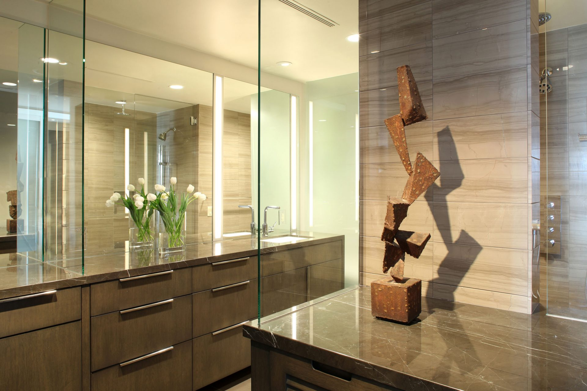 Gorgeous natural limestone slabs give this Century Towers condo renewed luxury