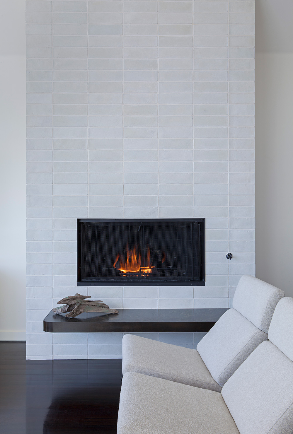 New masonry chimney with cantilevered stone-slab hearth in Manhattan Beach