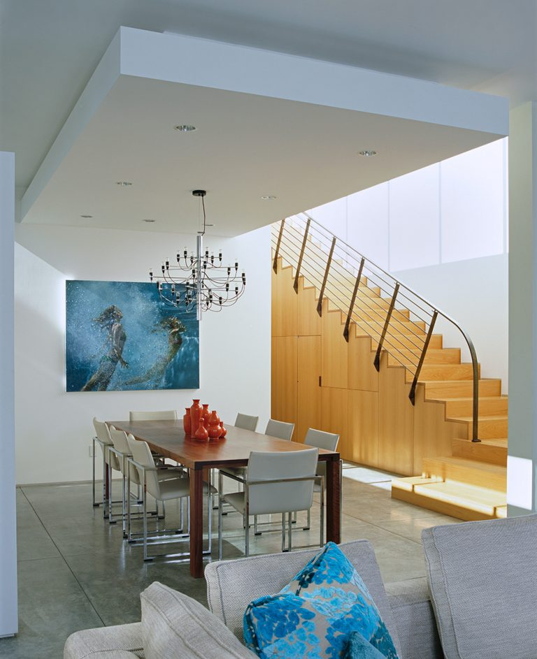 Angled stairway leading into a gorgeous dining room