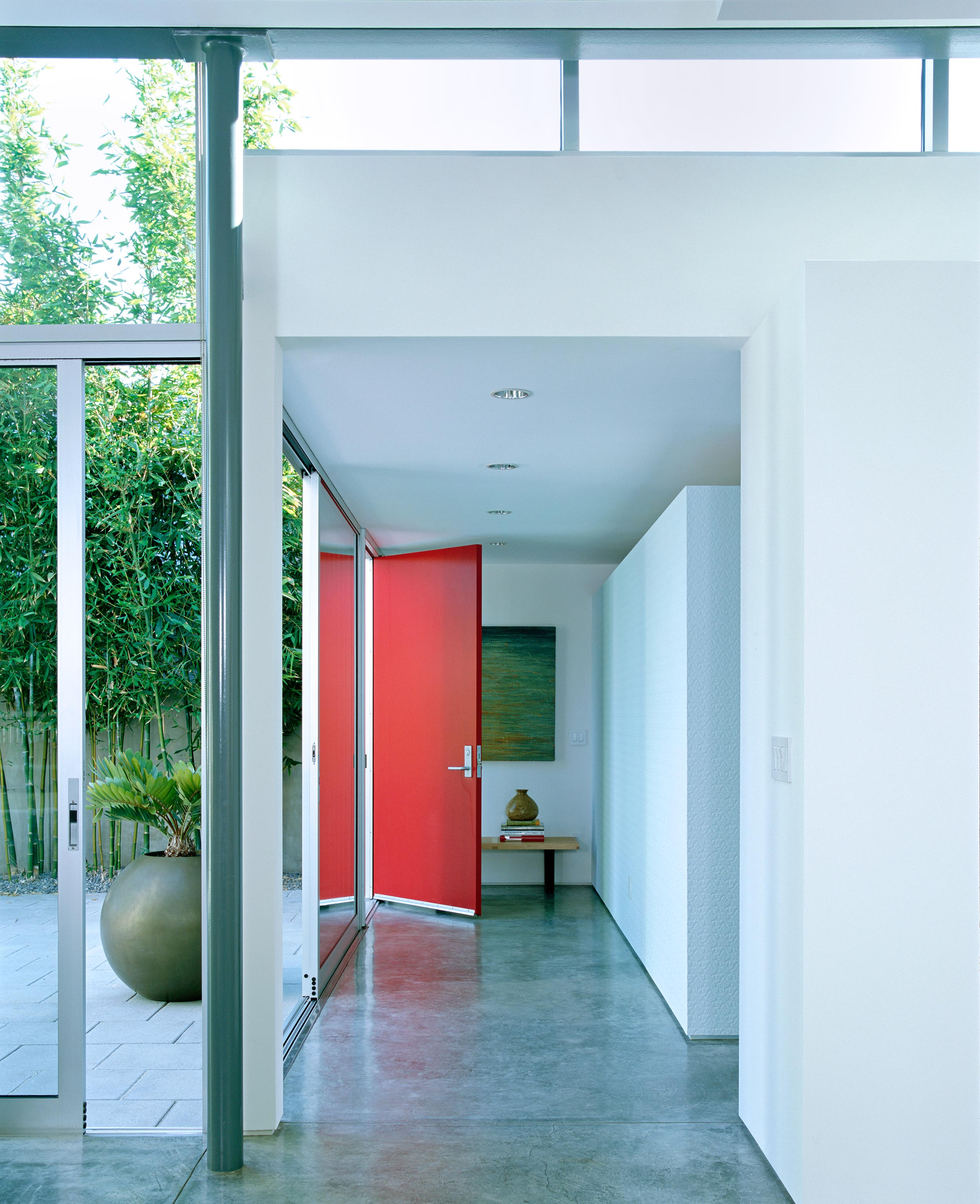 Entry hallway with red door at Newport Beach residence in CA