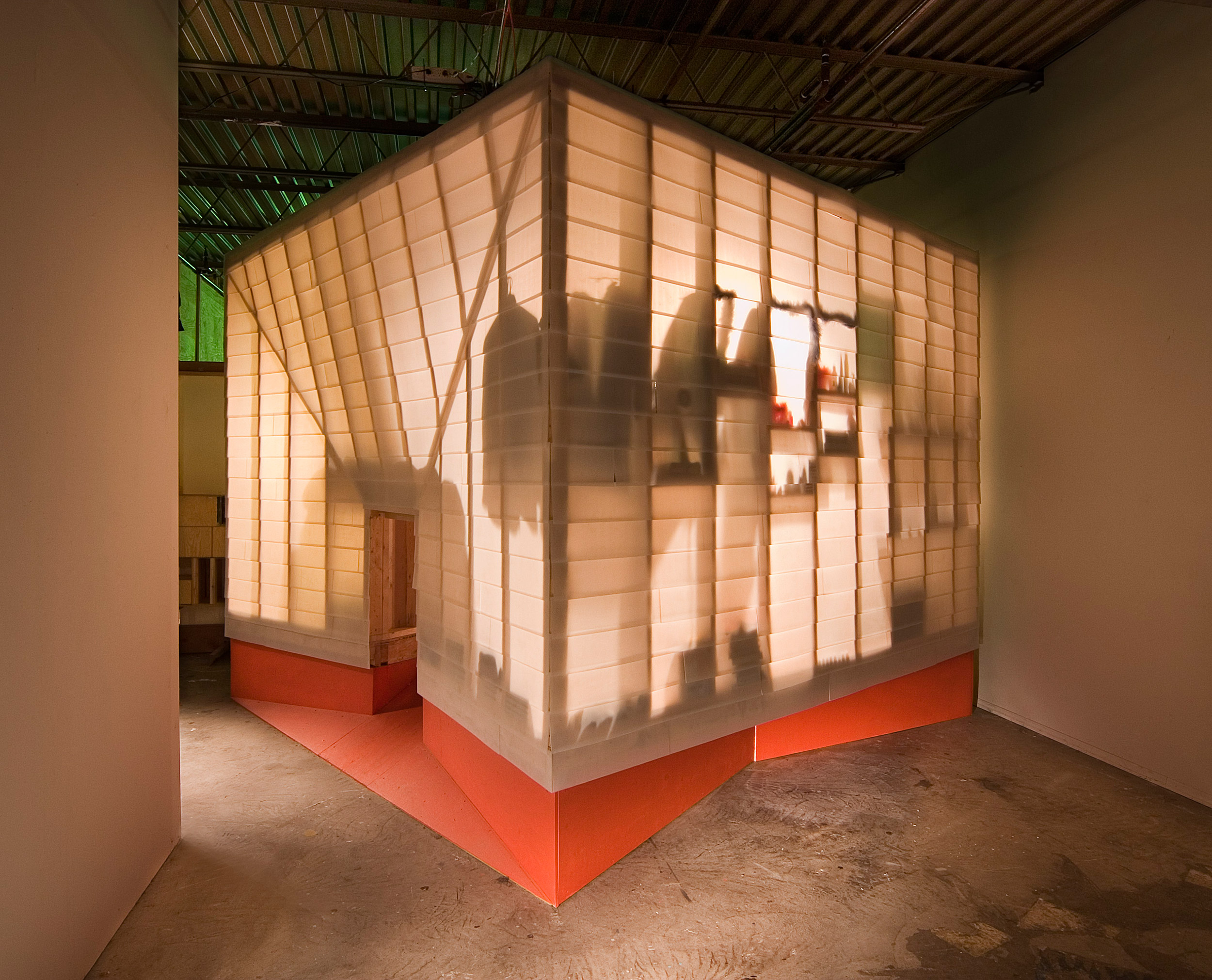 Writer's hut covered in translucent plastic shingles for experimental design project