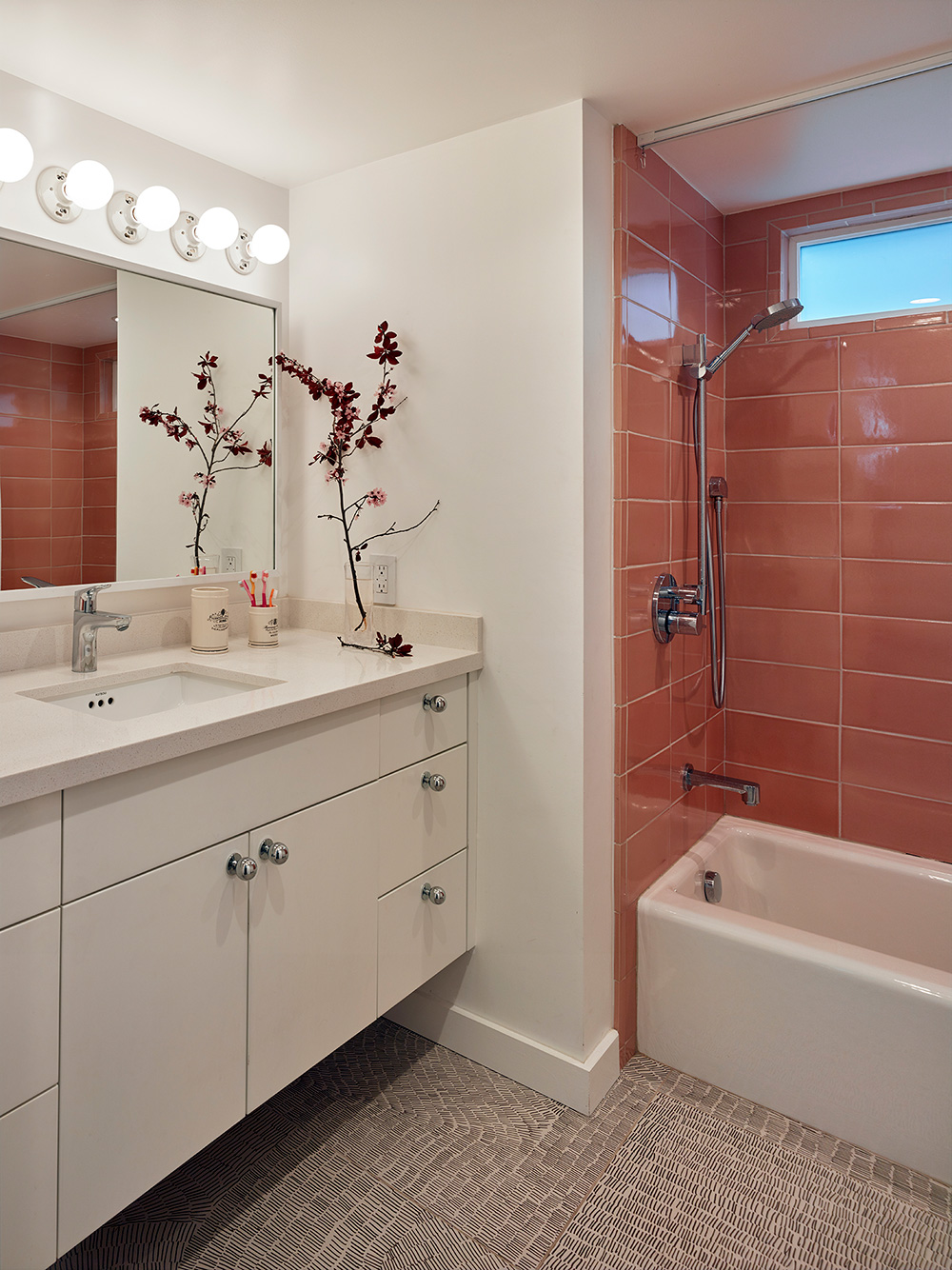 Colored ceramic, strategic finishes, and new lighting transform the bathroom in this 1970s California home