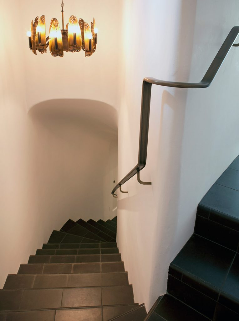 Stairs leading to a custom wine cellar design by Paul Davis Architects